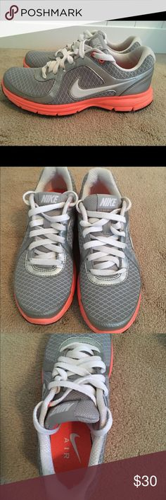 Nike tennis shoes Silver and white with bright orange accents. Look new - only worn a couple of times. Nike Shoes Athletic Shoes