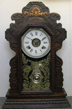 Ansonia Gingerbread Clock  8 day striking movement, made in new York c1800s, rare with original alarm and glass, fully refurbished   Price: NZ$950.00   Reference: #0353