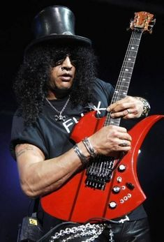 Slash Paradise - Photo, picture and image gallery: Slash live, on stage and in concert with Guns N' Roses, Slash's Snakepit, Velvet Revolver and Myles Kennedy. Guns N Roses, Saul Hudson, Gary Clark Jr, Velvet Revolver, Myles Kennedy, Folk Festival, Patti Smith, Gothic Anime, Welcome To The Jungle