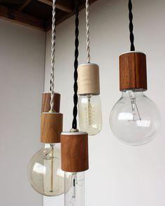 Wood veneered pendant light with 12 cord plug by onefortythree, $45.00