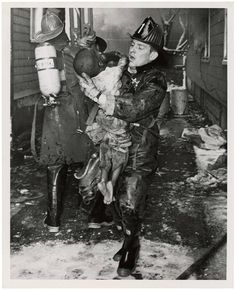 """""""Fire fighter rescuing child"""" ca. 1960 ~ God bless our civil servants Old Pictures, Old Photos, Vintage Photos, Fire Department, Fire Dept, Historical Images, Thing 1, Interesting History, World History"""