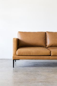 The Lennon Sofa by Project 82 designed for us by Cameron Foggo for our Staple&Co collection.  #masculineinteriors #tanleather #tanleathersofa #tanleathercouch #tanleatherlounge  #brownleather #designerfurniture #mancave  #minimal #loungeroom #interiordesign #mancave #tanleather #leathercouch #leathersofa #loungeroom #livingroom   #corporateinteriors #commercialinteriors #cameronfoggo #leathersofalivingroom #livingroom