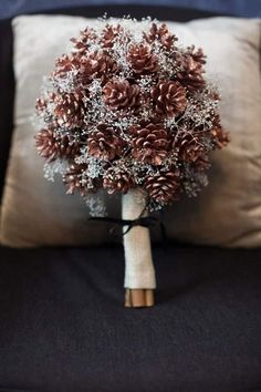 Pine cone and glittery babys breath bouquet for winter wedding. #weddinginspo