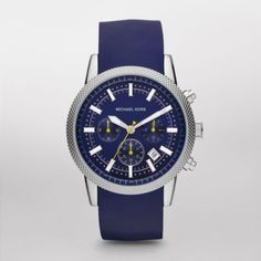Scout Blue Silicone Chronograph Watch This Michael Kors timepiece features a shiny stainless steel case with a blue chronograph dial. A blue silicone strap completes the look.