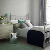 Pale grey bedroom with nickel bed