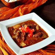 "Tomato Bredie""This is a traditional South African meal, and is good winter fare. Bredie is an old Cape name for a dish of meat and vegetables stewed together so that the flavors intermingle."