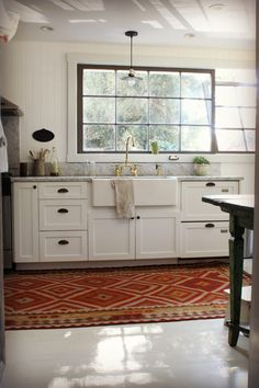 Rug-in-the-kitchen + cool industrial windows, via Real Inspired.