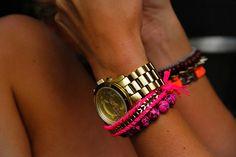 Gold watch + bright bracelets