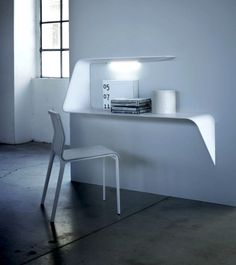 Mamba desk/ shelf by MDF Italia and designed by Victor Vasilev. Limited space use, LED light included in the shelf, minimalist shape... when esthetics and functionality meet, it's genius design!