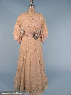 CREAM LACE TEA GOWN, c. 1913 Princess lace appliqué on net over pink chiffon, slight train, cream China silk lining, waist sash of pink & sage green chiffon. Front