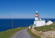Lighthouse located at Rinrawros Point at the north west corner of Arranmore Island. The lighthouse was built in 1859 replacing an earlier one of 1798 which had been decommissioned in Donegal, North West, Places To Travel, Ireland, Mountains, Lighthouses, Building, Beach, Water