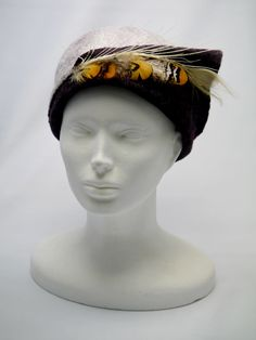 woolen felted hat with feathers
