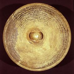 Incantation bowl from Mesopotamia, ca. seventh century. Usually buried in a building's foundation, magic bowls were designed to protect a house and its inhabitants from devils and evildoers. Opinion differs as to the actual ritual associated with these incantation bowls, but it is generally believed that they were thought to entrap and reject evil powers. As is common in these bowls, the Aramaic inscription here is written on the inside in concentric circles.