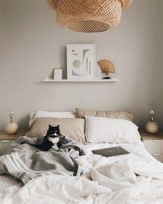 beige bedroom with Ikea Sinnerlig pendant and beige pillowcases