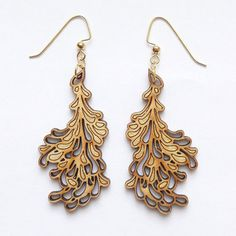 These floral-inspired earrings are made of lightweight bamboo, for extra dangle. Laser-cut to highlight their clean design, the Blossom Earrings are precisely the wardrobe flourish you've been looking for.