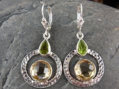 Made with 10mm round faceted citrine quartz and 6x8mm pear-shaped faceted peridot gemstones, sterilin silver bezel, metal, and leverback earring wires.