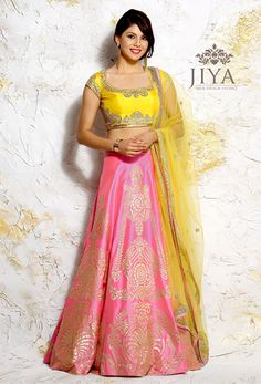 A contemporary with Gold Suede appliqued onto a bright pink silk in large chandelier motifs. Paired with a bright yellow marigold rawsilk choli detailed with zardosi embroidery. The outfit comes with a matching net dupatta.