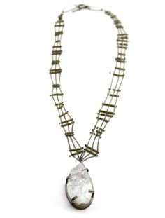 Topaz slice necklace by Karen Gilbert, with oxidized sterling silver, and stone beads. Gallery Lulo.