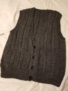A maddy laine knitting pattern for a classic men's vest featuring a simple cable pattern to knit in a DK weight yarn, making it light enough to be comfortable but ready to add a layer of warmth for the coming fall and winter season. Dk Weight Yarn, Vest Pattern, Classic Man, Winter Season, Ravelry, Knitwear, Knitting Patterns, Fiber, Sweaters