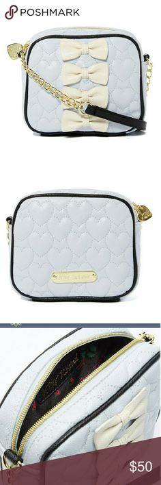 """NWT Betsey Johnson Bow-Accent Cross Body Bag NWT. Cream colored bows adorn this pale blue Betsey Johnson bag. Accented with gold tone hardware and black strap. 6.5"""" W x 6.0"""" H x 2.5"""" D. Shoulder drop is 24"""". Outside is man-made, and inside is polyester. Inside has one slip pocket. Betsey Johnson Bags Crossbody Bags"""