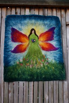 For inspiration: I think this is  combination of wet felting and needle felting.  Gorgeous.