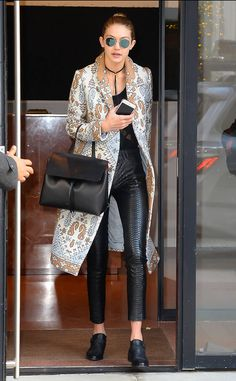 Pretty in Print from Gigi Hadid's Street Style  The top model is spotted in a long coat, black blouse and black leather pants while leaving her apartment in New York.