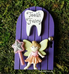 Welcome the Tooth Fairy with her very own special door! I hand painted the wood pixie-sized door in pink outdoor paint, sun dried it and affixed the tiny fairy, wooden tooth-shaped Tooth Fairy sign and teenie tiny magic wand securely with weatherproof glue. This tooth fairy sign and door are handcrafted by me from start to finish in Chicago. Once I created the designs, the wood sign and door are cut for precision according to my design blueprint - which include the adorable keyhole and…