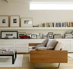 Long and low drawers below and open shelves above running full length