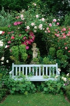 Love this little bench and the statue with the roses. So very calming.