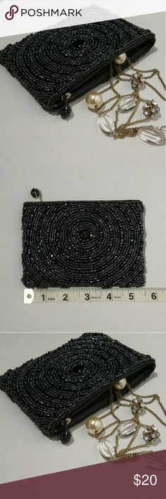 Black beaded pouch / clutch Beaded mini pouch or clutch is excellent like new quality. Shiny black hemitite-look beads in a concentric circle pattern, both sides the same, with a beaded zipper pull. Fully lined.   Great for storing favorite jewels, travel, or for carrying the essentials for a night out!  5.5 x 4 inches Bags Clutches & Wristlets