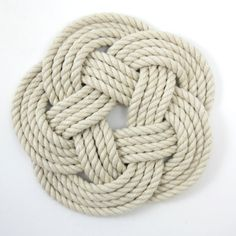 This is considered Mystic Knotwork, it doesnt look like much but I personally find it quite interesting. It is cool not only how you cannot find an end or beginning of one rope but how they were able to make that sense of infinity happen neatly for three ropes. I've worked with some rope before and have only experienced how whenever you want the rope to be a certain way it wont go that way. I would totally love to make this one on a larger scale