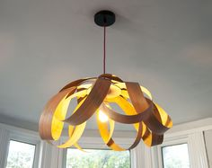 """Petal"" Lampshade in cherry wood. All of Randomlights designs are inspired by Scaninavian designs from both past mid century classics and present modern designs. They follow the same ethos of mimimalism, functionality with beautiful aesthetics guided by shapes in nature. - See more at: http://randomlights.com/products/petal-large-lampshade-cherry-wood/#tab-description #lighting #pendantlampshade #scandinaviandesign"