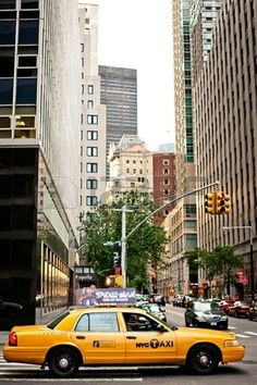 New York City. Taxicabs with their distinctive yellow paint, are a widely ...