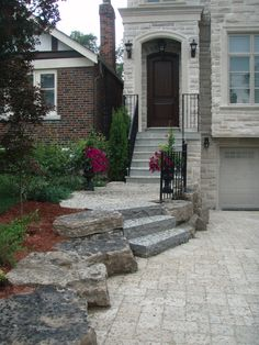 Interlocking tumbled stone driveway and flagstone steps, drive lined with Armour stone.