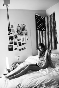 Here's an outtake from an Urban Outfitters shoot in my current bedroom. In this photo you can see: my grandpa's old American flag, wild turkey feathers from Kansas, a dreamcatcher from The Crystal...