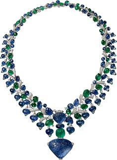 CARTIER. Collier / Pendentif - platine, un saphir de Birmanie gravé de 110,29 carats, un saphir de Birmanie gravé de 21,20 carats, une émeraude de Zambie côtelée de 18,42 carats, émeraudes gravées, saphirs gravés, diamants taille brillant. Le saphir est amovible et peut être porté sur une chaîne. #Cartier #CartierMagicien #HauteJoaillerie #FineJewelry #CarvedStones #TuttiFrutti