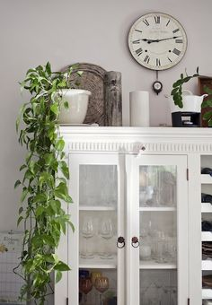 like the cabinet, clock, plant, nice effect
