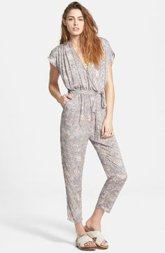 Free shipping and returns on Free People 'Universal' Surplice Jumpsuit at Nordstrom.com. A flouncy tie snugs the waistline of a vintage-inspired short-sleeve jumpsuit featuring a plunging surplice front, V-back and straight-leg pants.