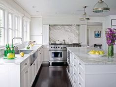 White kitchen and dark wood floors