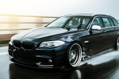Rolling shots in the rain of BMW F11 Touring.