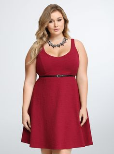 Berry sweet and amazing to touch, this skater style rocks a flirty v-neck that extends into a fitted bodice and flared skirt. Allover texture on the red fabric creates an eye-catching illusion. A black faux-leather belt adds a finishing touch, cinching your waist.