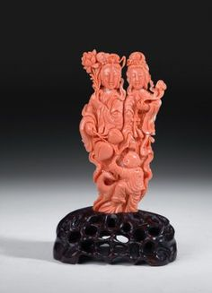 A Chinese Carved Red Coral Figural Group