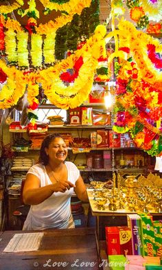 Quatre Bornes Market, Mauritius: A colorful shop to match its colorful, friendly owner. After first posing awkwardly for the photo, we decided to start asking her questions about the incense she was selling and that seem to loosen her up.