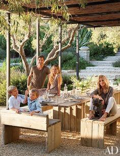 At their Frank Gehry–designed residence in Malibu, California, actor Patrick Dempsey and his wife, Jillian, are joined by their children in an alfresco dining space in the garden. Source: Architectural Digest. #Agraria  #lavender #garden http://www.agrariahome.com/lavender-and-rosemary-petiteessence-diffuser/