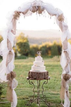 rustic burlap and tulle wedding arch