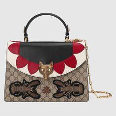 Broche GG Supreme top handle bag