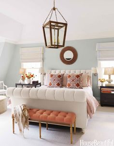 To add punch to the master bedroom of an Old Greenwich, Connecticut, house, designer Lee Ann Thornton upholstered a bench in an orange linen, Tuska/19 from Malabar. The John Robshaw print on the throw pillows reinforces the orange theme. The bed is upholstered in Stella Sand from Lulu DK. Lantern and nightstands from Mecox Gardens.   - HouseBeautiful.com