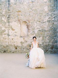 Ethereal Forbidden Love Story in Ancient Ruins #tulleweddingdresses #naturalweddingflowers #loosebridalupdo