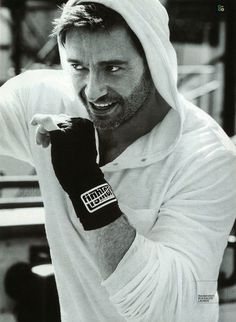 RLX Hugh Jackman sports an RLX tee for a behind the scenes workout in Mens Fitness