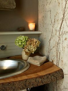 Woodland Escape        Give a traditional bathroom a contemporary twist by going big with natural elements. Ethereal wallpaper, a reclaimed mirror, and a wood slab countertop combine for a beautiful textural bath with all the right touches.